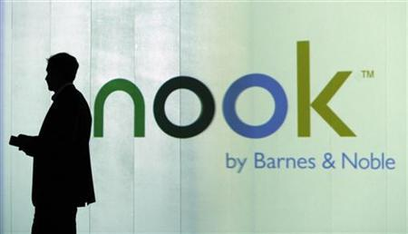 William Lynch, President of of Barnes & Noble.com, is seen as a silhouette during the launch of nook, the Wireless eBook Reader, at a news conference in New York October 20, 2009. REUTERS/Shannon Stapleton