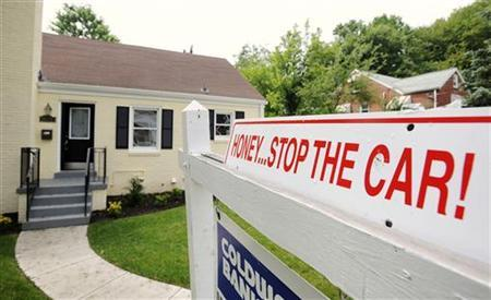 A sign reading ''Honey... Stop the car!'' is seen as it announces a house for sale in Silver Spring, Maryland, May 23, 2010. REUTERS/Jonathan Ernst