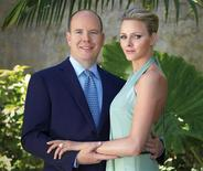 <p>Prince Albert of Monaco poses with Charlene Wittstock in Monaco in this June 23, 2010 handout photo released by the palace. Prince Albert II of Monaco, son of the late Hollywood actress Grace Kelly, is to marry former South African Olympic swimmer and model Wittstock, the prince's office said in a statement on Wednesday. REUTERS/Amedeo M.Turello/Palais Princier/Handout</p>