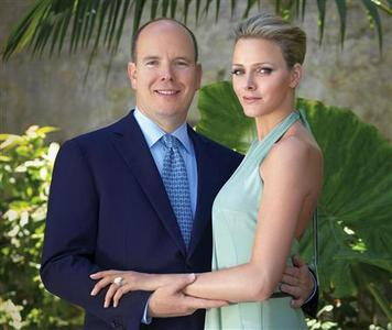 Prince Albert of Monaco poses with Charlene Wittstock in Monaco in this June 23, 2010 handout photo released by the palace. Prince Albert II of Monaco, son of the late Hollywood actress Grace Kelly, is to marry former South African Olympic swimmer and model Wittstock, the prince's office said in a statement on Wednesday. REUTERS/Amedeo M.Turello/Palais Princier/Handout