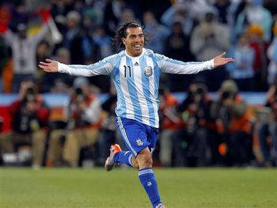 Argentina's Carlos Tevez celebrates after scoring his second goal during a 2010 World Cup second round soccer match at Soccer City stadium in Johannesburg June 27, 2010. REUTERS/Enrique Marcarian
