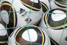 <p>Jabulani soccer balls are pictured before an international friendly soccer match between Switzerland and Costa Rica in Sion June 1, 2010. REUTERS/Denis Balibouse</p>