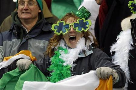 An Ireland fan holds the national flag during their Six Nations rugby union match against France at the Stade de France stadium in Saint Denis, near Paris February 13, 2010. REUTERS/Benoit Tessier