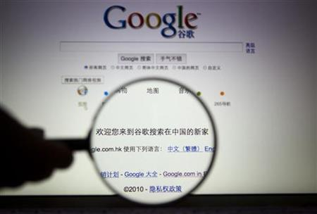 A person poses with a magnifying glass in front of a Google search page in this illustrative photo taken in Shanghai, March 23, 2010. REUTERS/Stringer