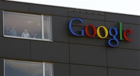 A company logo is placed on the roof of the Google building in Zurich May 25, 2010. REUTERS/Arnd Wiegmann