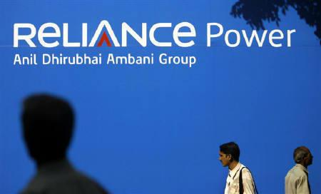 People walk past a billboard advertising Reliance Power, at the Bombay Stock Exchange (BSE) in Mumbai February 11, 2008. REUTERS/Punit Paranjpe/Files