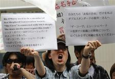 "<p>An activist protesting against the screening of the movie ""The Cove"" holds placards in front of a theatre in Tokyo July 3, 2010. Protesters gathered at the Japanese opening of ""The Cove"", a controversial Oscar-winning documentary about a grisly annual dolphin hunt. Dozens of polices and some 50 people, both for and against the screening, faced off in front of a theatre in Tokyo's Shibuya district on Saturday. REUTERS/Issei Kato</p>"