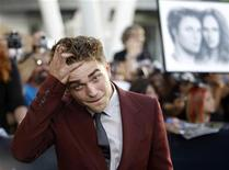 "<p>Cast member Robert Pattinson poses at the premiere of ""The Twilight Saga: Eclipse"" during the Los Angeles Film Festival at Nokia theatre at L.A. Live in Los Angeles June 24, 2010. REUTERS/Mario Anzuoni</p>"