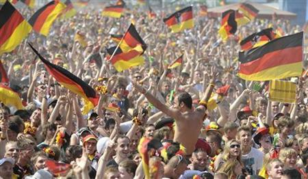 German soccer fans celebrate their team's first goal at a public viewing event in northern German city of Hamburg during the 2010 World Cup quarter-final match against Argentina in South Africa, July 3, 2010. REUTERS/Morris Mac Matzen