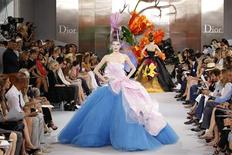 <p>Models present creations by British designer John Galliano as part of his Fall/Winter 2010-2011 Haute Couture fashion show for French fashion house Dior in Paris July 5, 2010. REUTERS/Benoit Tessier</p>