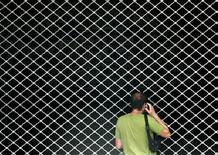 <p>Man speaks on phone as he stands in front of closed metro station in Athens during 24 hour nationwide strike. REUTERS/Yiorgos Karahalis</p>
