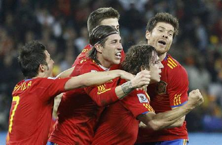 Spain's Carles Puyol (C) celebrates his goal with team mates during the 2010 World Cup semi-final soccer match against Germany at Moses Mabhida stadium in Durban July 7, 2010.  REUTERS/Jerry Lampen