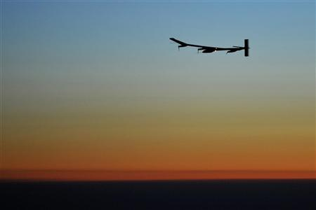 Solar Impulse's Chief Executive Officer and pilot Andre Borschberg flies during sunset in the solar-powered HB-SIA prototype airplane during its first night flight attempt near Payerne airport July 7, 2010. REUTERS/Dominic Favre/Pool