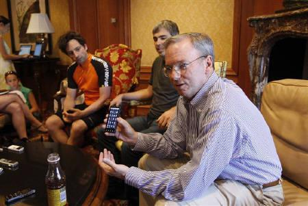 Google Chairman and Chief Executive Eric Schmidt (R) holds a Droid X smartphone, as co-founders Sergey Brin (L) and Larry Page watch, while he talks to reporters at the Sun Valley Inn in Sun Valley, Idaho July 8, 2010. The resort is the site for the annual Allen & Co's media and technology conference. REUTERS/Mario Anzuoni