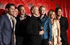"<p>Creator and director of the show ""Glee"", Ryan Murphy (C), holds an award as he is surrounded by cast members during the 2010 Peabody Award ceremony at the Waldorf Astoria in New York May 17, 2010. The cast members include actors Matthew Morrison (L), Jane Lynch (3rd R) and Jessalyn Gilsig (2nd R). REUTERS/Lucas Jackson</p>"