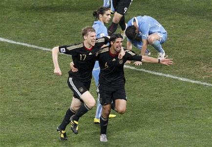 Germany's Sami Khedira (R) celebrates with team mate Per Mertesacker after scoring against Uruguay during their 2010 World Cup third place playoff soccer match in Port Elizabeth July 10, 2010. REUTERS/Oleg Popov