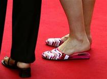 <p>Guest wears sandals during red-carpet arrivals for the official screening of a film entry at the 56th International Film Festival in Cannes, May 19, 2003. REUTERS/Vincent Kessler</p>
