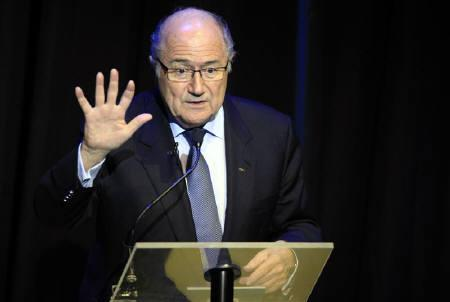 FIFA President Sepp Blatter gestures the number of times Brazil won the World Cup as he speaks during the launch of the ''Road to Brazil 2014'' and the unveiling of the official emblem at the the Sandton Convention Centre in Johannesburg, July 8, 2010. REUTERS/Radu Sigheti