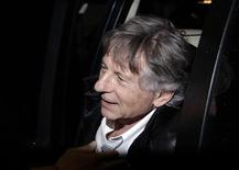 <p>Film director Roman Polanksi arrives at the 44th Montreux Jazz Festival in Montreux July 17, 2010. Polanski's wife, the French actress and singer Emmanuelle Seigner, performs on the closing day of the 16-day Swiss event. Polanski had been freed on Monday from house arrest in his chalet in the Swiss resort of Gstaad after Swiss judicial authorities announced they would not extradite him to the United States. REUTERS/Denis Balibouse</p>
