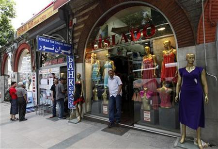 A shopkeeper waits for customers next to an Iranian travel agency in Istanbul June 24, 2010. REUTERS/Murad Sezer