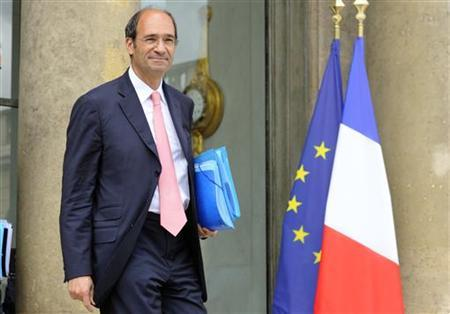 French Labour Minister Eric Woerth leaves the Elysee Palace following the weekly cabinet meeting in Paris, July 13, 2010. REUTERS/Philippe Wojazer