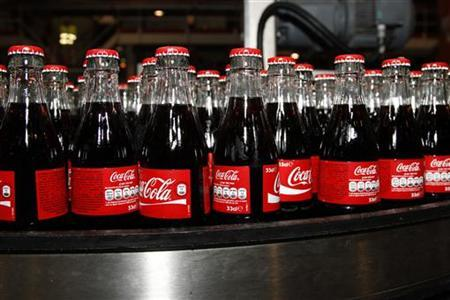 Bottles of Coca-Cola are seen on the production line at their bottling plant in Clamart near Paris June 10, 2010. REUTERS/Jacky Naegelen