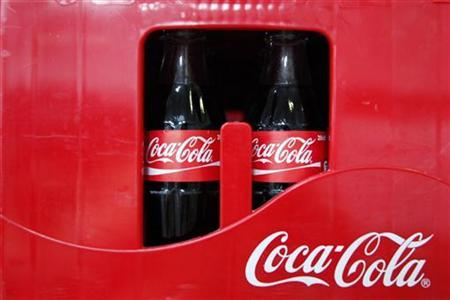 Cases holding bottles of Coca-Cola are seen on the production line at their bottling plant in Clamart near Paris June 10, 2010. REUTERS/Jacky Naegelen