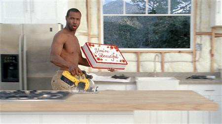 Isaiah Mustafa in a commercial for Old Spice. REUTERS/P&G