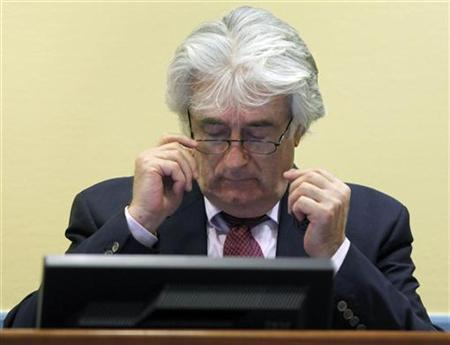 Former Bosnian Serb leader Radovan Karadzic appears in the courtroom of the International Criminal Tribunal for the former Yugoslavia (ICTY) for an administrative hearing in his war crimes trial in the Hague, November 3, 2009. REUTERS/Michael Kooren/Pool