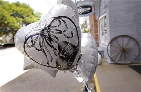 Wedding bell balloons fly from a storefront in Rhinebeck, New York, July 26, 2010. REUTERS/Mike Segar