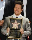 <p>Actor Mark Wahlberg poses with his plaque after his star was unveiled on the Hollywood Walk of Fame in Hollywood, California, July 29, 2010. Wahlberg's star is the 2,414th star on the Walk of Fame. REUTERS/Danny Moloshok</p>