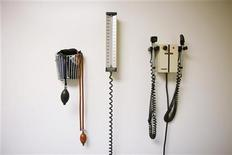 <p>Devices used to take blood pressure, temperature, and examine eyes and ears rest on a wall inside of a doctor's office in New York March 22, 2010. REUTERS/Lucas Jackson</p>