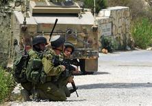 <p>Израильские солдаты у границы с Ливаном 3 августа 2010 года. Израильские и ливанские войска во вторник устроили перестрелку на границе двух государств, есть жертвы, сообщили свидетели инцидента и источники в службах безопасности двух стран. REUTERS/Hamad Almakt</p>