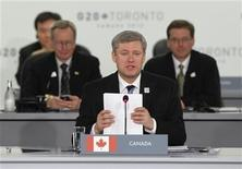 <p>Prime Minister Stephen Harper delivers remarks during the opening plenary session of the G20 Summit in Toronto, June 27, 2010. REUTERS/Jason Reed</p>