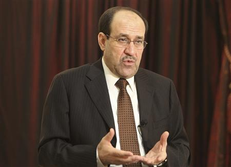 Iraq's Prime Minister Nuri al-Maliki speaks during an interview with Reuters in Baghdad, August 6, 2010. Al-Maliki said in an interview with Reuters he was still determined to serve a second term despite an impasse with his allies in talks to form a coalition government. Picture taken August 6, 2010. To match interview IRAQ-POLITICS/MALIKI REUTERS/Thaier al-Sudani