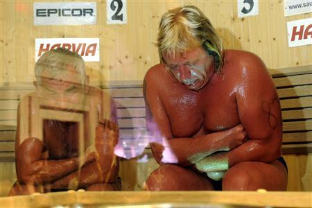 Russia's Vladimir Ladyzhenskiy (L) and Finland's Timo Kaukonen take part in the finals of the Sauna World Championships in Heinola August 7, 2010. REUTERS/Sari Gustafsson/Lehtikuva