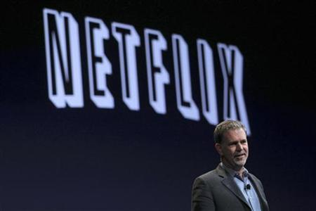 Netflix CEO Reed Hastings speaks during the unveiling of the iPhone 4 by Apple CEO Steve Jobs at the Apple Worldwide Developers Conference in San Francisco, California June 7, 2010. REUTERS/Robert Galbraith