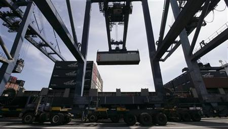A container is unloaded from a cargo ship at the Jakarta International Container Terminal in this March 18, 2010 file photo. REUTERS/Pablo Sanchez