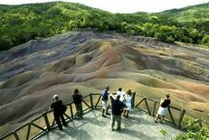 <p>Tourists survey the unusual natural phenomena of the seven-coloured earth at Chamarel in west Mauritius November 11, 2003. REUTERS/Darrin Zammit Lupi DZL</p>
