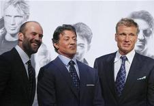 "<p>U.S. actor Sylvester Stallone (C), British actor Jason Statham (L) and Swedish actor Dolph Lundgren arrive for the German premiere of their new movie ""The Expendables"" in Berlin, August 6, 2010. REUTERS/Thomas Peter</p>"