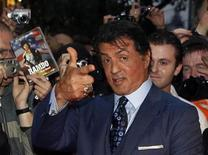 "<p>U.S. actor Sylvester Stallone poses with fans as he arrives for the German premiere of his new movie ""The Expendables"" in Berlin, August 6, 2010. REUTERS/Thomas Peter</p>"