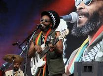 <p>Singer and bass player Ras I Ray of the Easy Star All-Stars belts out some reggae/dub at Fairport's Cropredy Convention in Oxfordshire, England, August 14, 2010. REUTERS/Jeremy Gaunt</p>