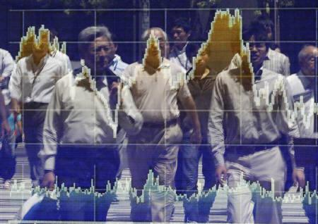 People are reflected on a stock quotation board outside a brokerage in Tokyo August 11, 2010.REUTERS/Toru Hanai/Files