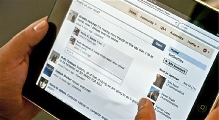 A Facebook page is shown on an iPad in this undated publicity image released to Reuters in Los Angeles August 17, 2010. REUTERS/Inigral Inc./Handout