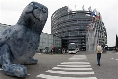 A giant inflatable baby seal is disposed in front of the European Parliament in Strasbourg May 5, 2009. REUTERS/Vincent Kessler