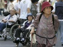 <p>A woman strolls through Tokyo's Sugamo district, an area popular among the Japanese elderly, September 20, 2007. REUTERS/Yuriko Nakao</p>