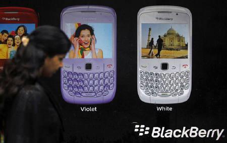 A woman walks past a Blackberry advertisement billboard in Mumbai August 17, 2010.  REUTERS/Danish Siddiqui/Files