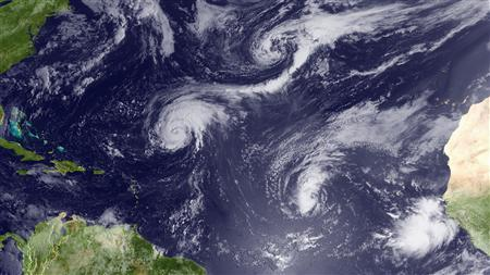 Hurricane Danielle, shown located southeast of Bermuda, and Tropical Storm Earl, shown located west of the Cape Verde Islands, in a satellite image taken August 26, 2010. REUTERS/NOAA