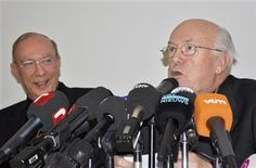 <p>Belgian Cardinal Godfried Danneels (R) and his successor Andre Mutien Leonard (L) address a joint news conference in Brussels January 18, 2010. REUTERS/Timothy Seren</p>