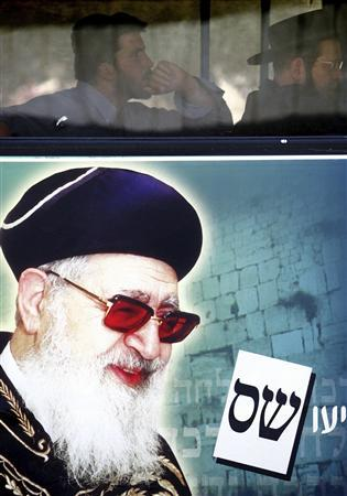 A campaign poster depicting Rabbi Ovadia Yosef, spiritual head of the religious Shas party, is seen on a public bus in Jerusalem in this March 21, 2006 file picture. The influential Israeli rabbi has said God should strike the Palestinians and their leader with a plague, calling for their death in a fiery sermon before Middle East peace talks set to begin next week. REUTERS/Yannis Behrakis/Files